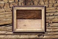 Old picture frame on a wooden background Royalty Free Stock Photo