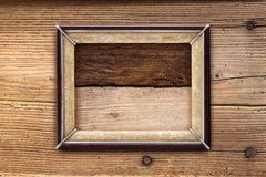 Old picture frame on a wooden background Stock Photo