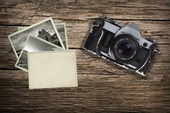 Old pictures with vintage camera on a leather case Royalty Free Stock Images
