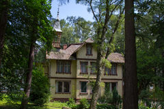 Old picturesque house is situated among the trees in the town of Svetlogorsk. Stock Image