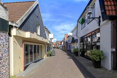 View at shopping street in Den Burg village on the wadden island. Old and picturesque houses, buildings and architecture typical on a shopping street downtown Stock Images