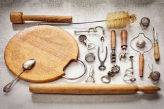 Old pieces of kitchen utensils on a table. The top view stock photography