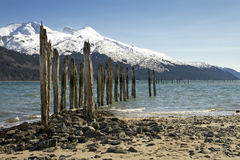 Old Pier in Alaska. An old pier at a mine in Juneau, Alaska against a mountain backdrop Royalty Free Stock Photos