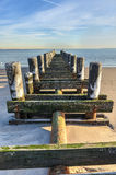 Old Pier on the Beach Stock Photography
