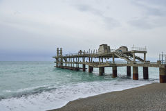 Old pier on the Black Sea. In morning Stock Image