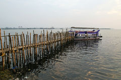 Old pier for boats made of bamboo Royalty Free Stock Image