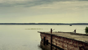 Old pier for boats on the river. Travel. Tourism. Recreation Stock Photos