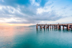 Old pier bridge in beautiful morning sunrise and calmness seascape. At Khao Laem Ya National park, Rayong Province, Eastern Thailand Royalty Free Stock Photo