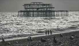 The old pier in Brighton and the beach. Stock Image