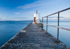 Old pier and calm sea Stock Images