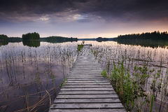 Old pier in Finland. Old pier at sunset in Finland Royalty Free Stock Photos