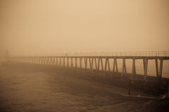 Old pier in fog. East pier, Whitby, partially obscured by thick fog royalty free stock photo