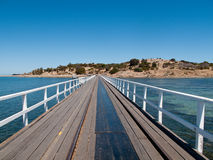 Old pier at Granite Island and Victor Harbor. Wooden pier and railway track at Granite Island and Victor Harbor near Adelaide in Australia royalty free stock photos