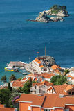 Old pier and islands in Petrovac, Montenegro Stock Photo