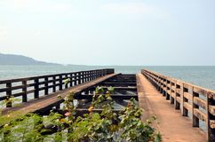 Old pier in Kep town. And view on Rabbit Island, Cambodia royalty free stock photos