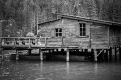 Old pier at lake of Braies in black and white stock image