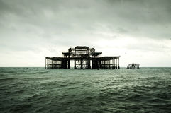 Old pier on the middle of the sea Royalty Free Stock Photos