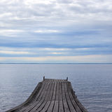 Old pier on nice lake Royalty Free Stock Photo