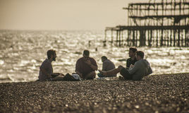 The old pier and the people on the beach, Brighton. Royalty Free Stock Photography