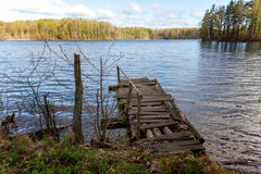The old pier. Perspective view of a old wooden pier in a lake stock photography