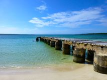Pier that leads into Caribbean waters, Cayo las Brujas stock photography