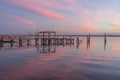 An Old Pier in the Pink Sky of Sunrise Royalty Free Stock Image