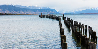 Old pier at puerto natales Royalty Free Stock Images