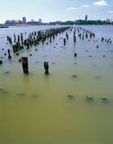 Old pier pylons. Jersey City skyline over old pier pylons on the Hudson River from Manhattan, New York Royalty Free Stock Photography