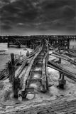 Old pier railway line Stock Images