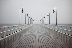 Old pier in rain on Baltic sea Orlowo Gdynia Poland Stock Images