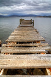 Old pier ruins. Remains of an ancient pier on the water, Tasmania, Australia stock photos