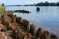 Old pier. Ruins of an old pier on the Neva River stock image