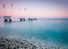 Old pier in the sea. Stock Image