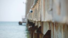 Old pier sea waves on the water.