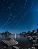 Old pier star trails. Star trails as seen over the old pier in Prescott, Ontario, Canada royalty free stock photography