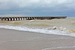 Old pier in stormy weather Stock Images
