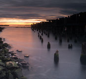 Old pier at sunrise Stock Photo