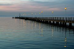 Old Pier Surrounded By Blue Water Royalty Free Stock Image