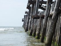 Old pier to sea in Lithuania. Old wooden pier to Baltic sea in Lithuania royalty free stock image