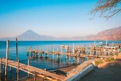 Old piers onto lake Atitlan with Vocano San Pedro in the backgro. Panajachel, Guatemala -March 1, 2016:  Old rickety wooden piers out into Lake Atitlan in Stock Image