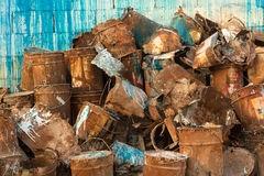 Old pile of rusty paint cans against wall Stock Photos