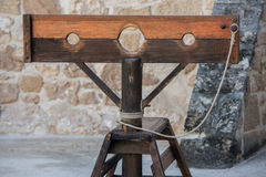 Free Old Pillory On Castle Stone Wall Background Royalty Free Stock Photography - 75297827