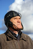 Old pilot looking to the sky. Old pilot in old uniform looking upstairs to the sky Royalty Free Stock Photography