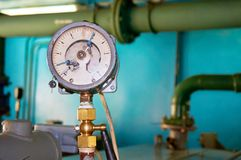 The old contact pressure gauge for pressure shows zero. Abstract background. Stock Photos