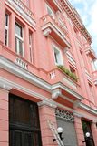 Old pink architectural building in Havana, Cuba Royalty Free Stock Image