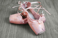 Old pink ballet shoes Stock Photos