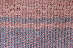 Old pink and blue cotton rug Stock Images