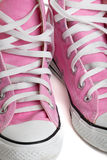 Old pink coloured basketball shoes Stock Image
