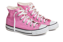 Old pink coloured basketball shoes Royalty Free Stock Photography