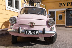 Old pink Fiat 600, Italian city car, front view. Porvoo, Finland - May 7, 2016: Old pink Fiat 600 city car produced by the Italian manufacturer Fiat from 1955 to stock photos